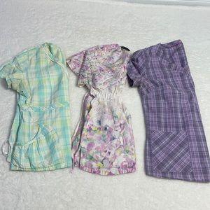 Lots of three size small Ladies scrub tops